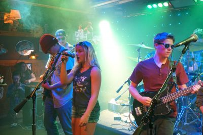 Teen rock band performing on stage