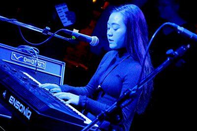 Girl playing keyboard on stage